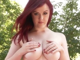 Gorgeous redhead babe with fair skin and big natural boobs Jaye Rose frolics outfoors