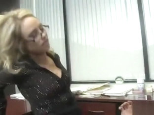 Charley Monroe is a long, blonde haired secretary, whos wearing her glasses