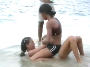 Dominican girls sexy wrestling on beach body to body