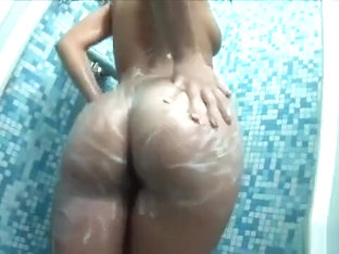 Delightful brunette Nila makes herself cum with a dildo in the shower
