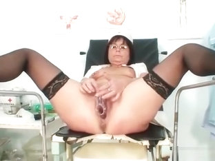 Old slut toys her pierced pussy on gynochair