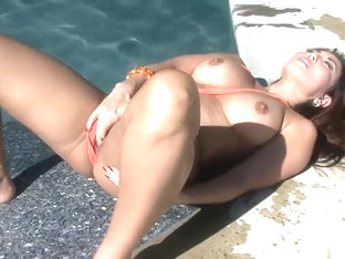 Akira Lane strips off her bikini before she pleasures her pussy