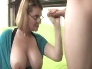 Busty mature is giving a tugjob