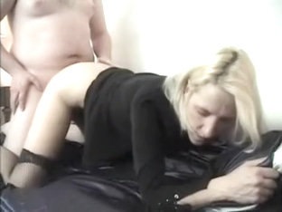 Stylish Blonde in red belt sucks big cocks in gang bang