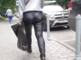 Sweet woman's ass in leather pants