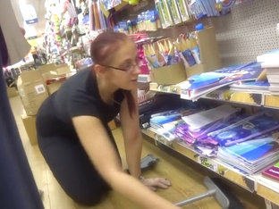 Store clerk bending over in front of me