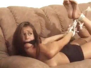 Long legged brunette milf tied on the couch
