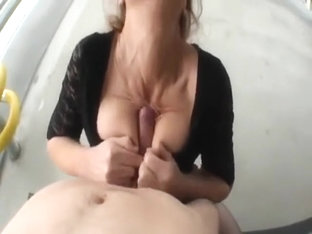 Mature Woman Blows Cock on a Public Balcony