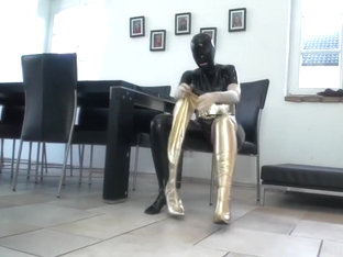 Shiny Black Catsuit Lady Piss In Golden Boots
