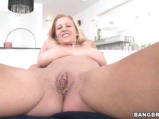 Big breasted mature Holly blows a huge hard cock