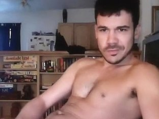 Seductive dude is masturbating in the guest room and filming himself on web camera