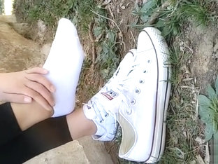 Chinese girl sprains foot in white ankle socks and black leggings