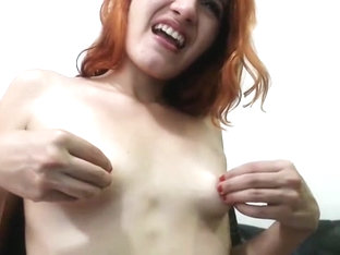 Redhead cutie with small saggy tits and big nipples
