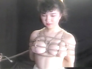 Older babe in a sexy kimono hogtied and stimulated