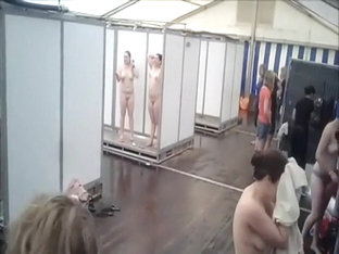 Lots of naked girls in a big public shower