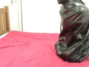 Redhead in Latex Suit getting Tied Up in Hood, Armbinder, and Bodybag