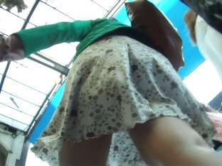 Wavy skirt showing mature ass on upskirt cam