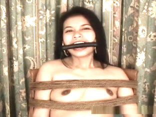 Asian chick tied up tightly on a chair