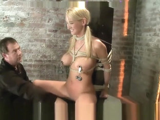 BOMBSHELL BLOND TIED SITTING AND IMPALED WITH A HUGE DILDO