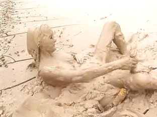 Lady masterbating in mud