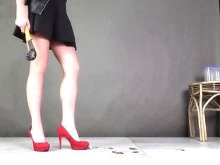 Bella crushing and grinding out roaches under red high heels.