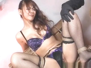 Beautiful Oriental babe in fishnet stockings has pussy filled with glowstic