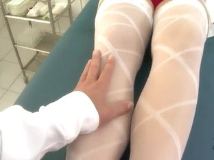 Cute busty nurse is performing great footjob