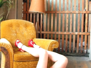 Corset on Mustard Chair bts she strips and touches her pussy during this