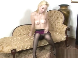 Skinny blonde angel poses in tights