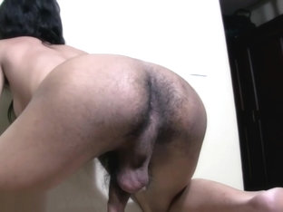 Long haired ladyboy gives handjob while exposing hairy butt