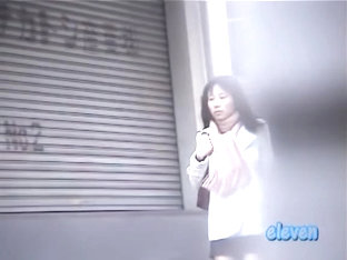 Cold Asian babe in a hurry gets a street sharking.