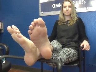 Blonde teen girl takes off her socks to show off her lovely perfect feet