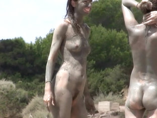 Dirty family naked on beach