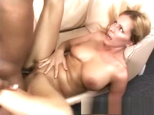 Buxom mom Nicole Moore has a dark stud banging her pussy on the couch