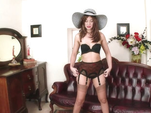 Experienced slut Tracy Rose takes off her panties and stockings.