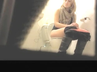 Blonde girl peeing in bathroom