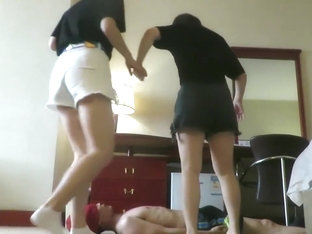 human floor for two asian girls trampling