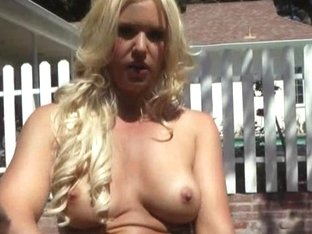 Sexy Bella Rose masturbates her pussy on a motorbike outdoors