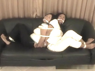 Two Asian hottie hogtied back to back action