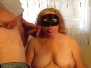 Masked Milf Redhead chewing gum with hot cum